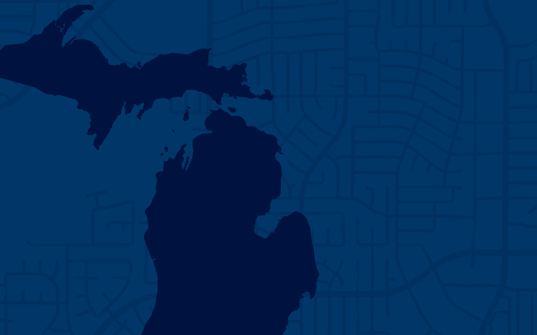 A blue map of Michigan layered over a blue neighborhood map