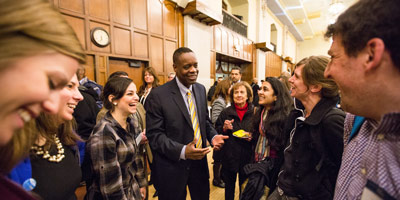 Photo of Kevyn Orr speaking with attendees after his Ford School talk