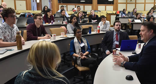 Photo of students engaging with a local policymaker