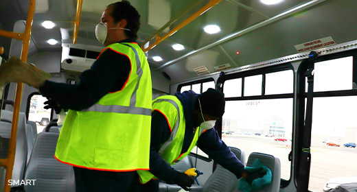 Photo of SMART employees sanitizing buses in Metro Detroit