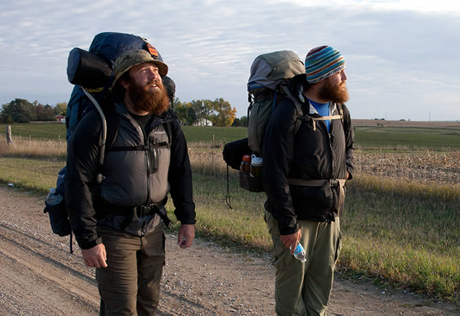 Veterans Tom Voss and Anthony Anderson begin trekking at sunrise in Iowa.