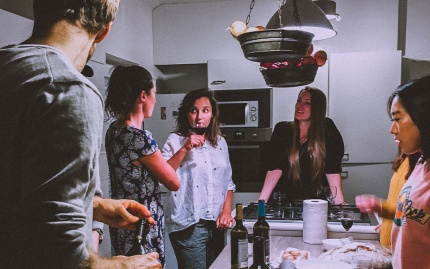 Friends gathered in the kitchen