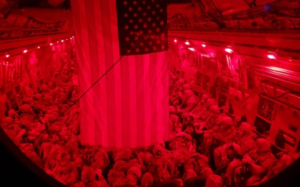 Photo of the interior of a U.S. military cargo plane filled with American and allied evacuees (credit: Minnesota National Guard / Lt. Col. Jake Helgestad)