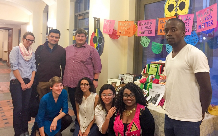 Students gather around an ofrenda for Black lives