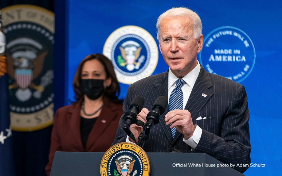 Photo of President Biden and Vice President Harris addressing people from a podium