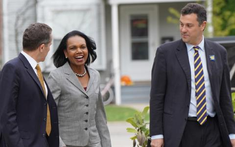 Michael S Barr, former Secretary of State Condoleezza Rice, and John Ciorciari walking outside in Ann Arbor