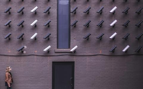 Dozens of security cameras pointed at one person