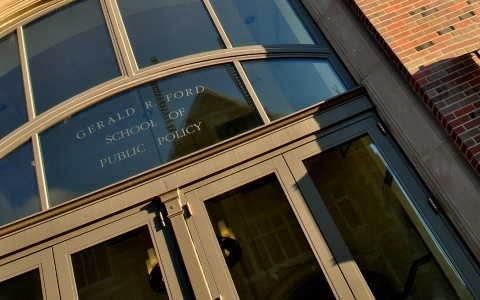 "Weill Hall entrance with ""Gerald R. Ford School of Public Policy"" etched into the glass"