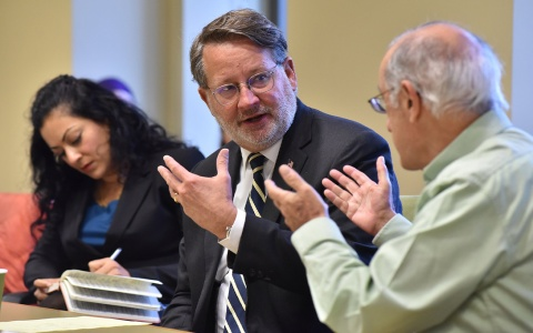 U.S. Senator Gary Peters (D-MI) at a roundtable hosted by the Ford School and shown here with Shobita Parthasarathy and Bob Axelrod.