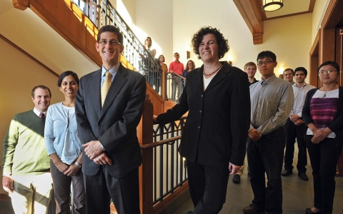 Brian Jacob, Sue Dynarski, and members of the Education Policy Initiative stand along the winding main staircase of the Ford School's home, Weill Hall